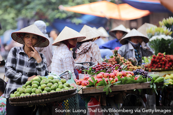 Image 6: Vietnamese peasants selling their goods at a market
